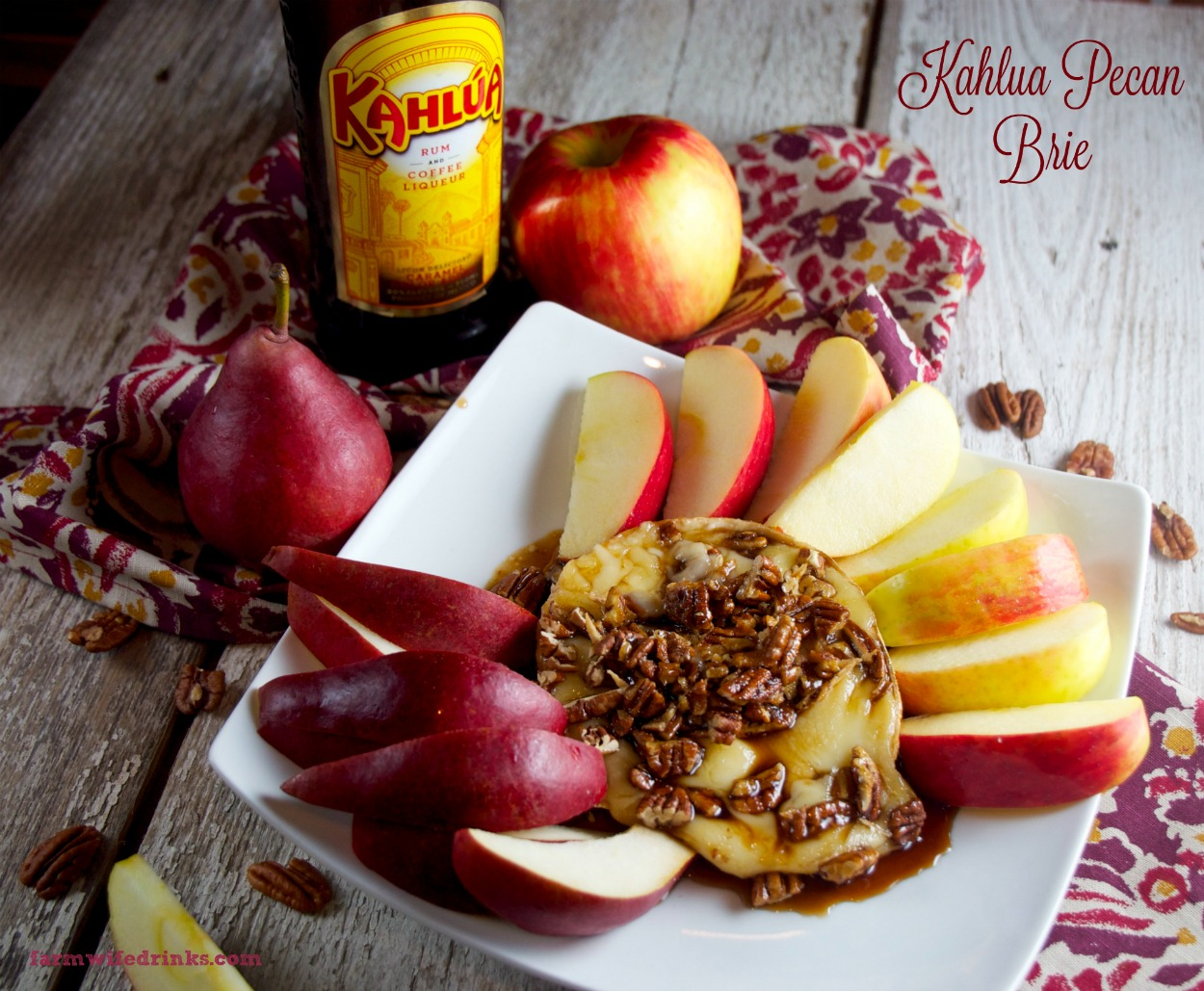 Baked Kahlua Pecan Brie is a perfect appetizer or dessert recipes served up with apple slices.