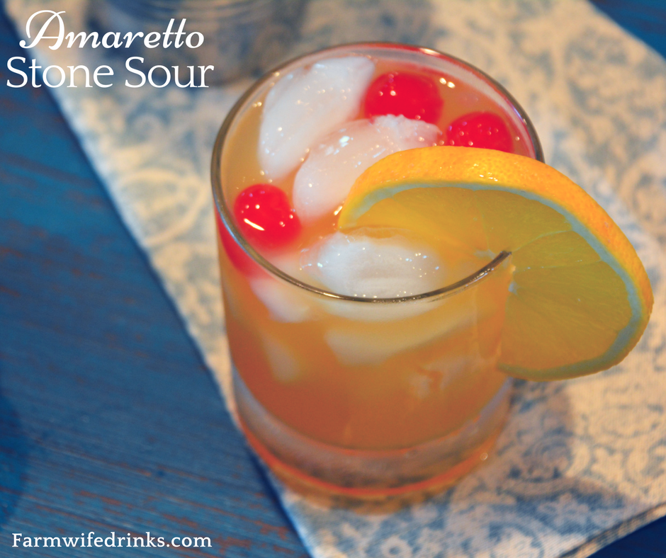 This sweet and tangy combination of Amaretto, sweet and sour and orange juice makes the perfect Amaretto Stone Sour. #Cocktail #Amaretto