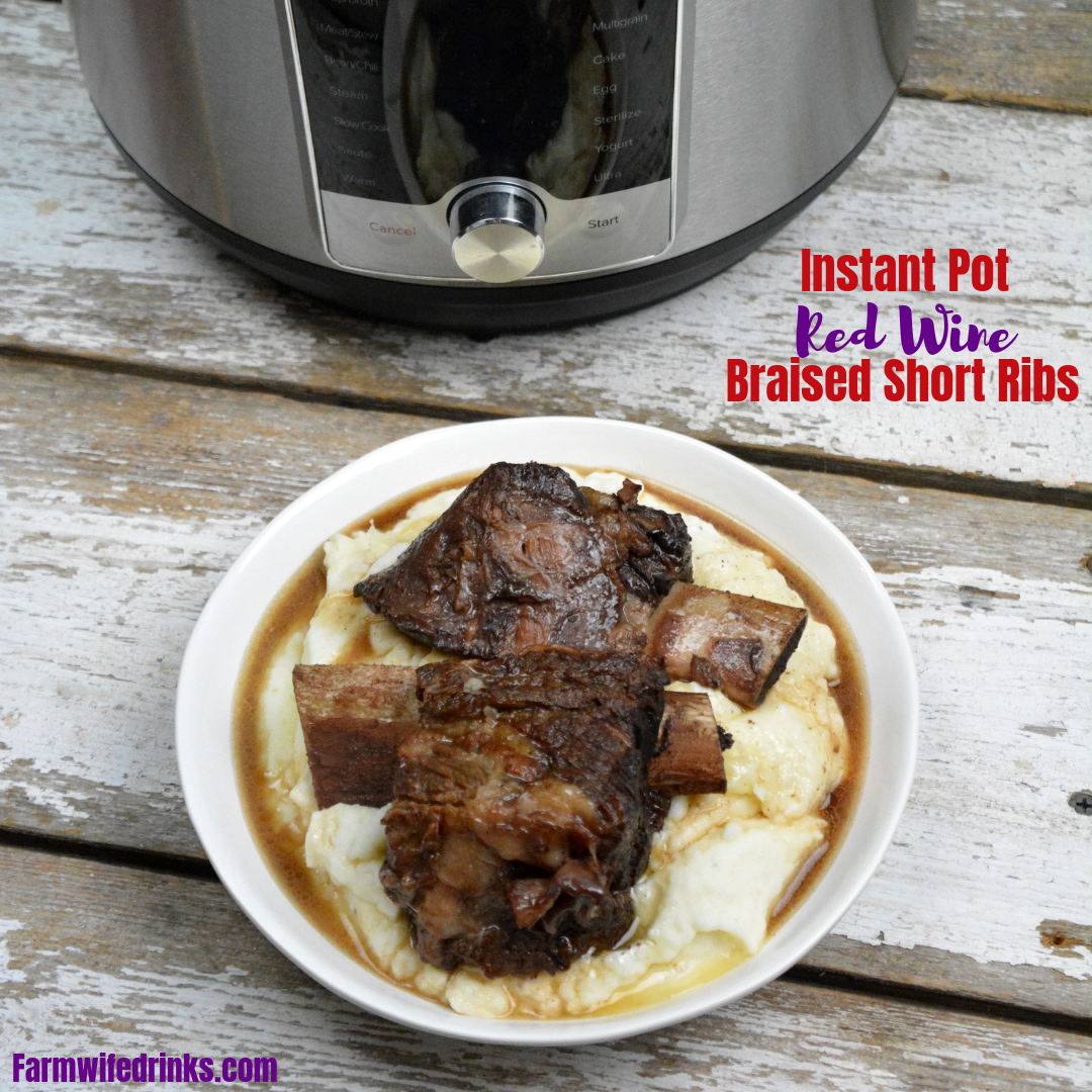 Instant Pot Red Wine Braised Short Ribs create a tender, juicy beef short rib recipe in under two hours. The beef falls off the bone after 90 minutes of pressured cooking in a bottle of red wine. #InstantPot #ShortRibs #Beef #Wine #RedWine #BeefRecipes