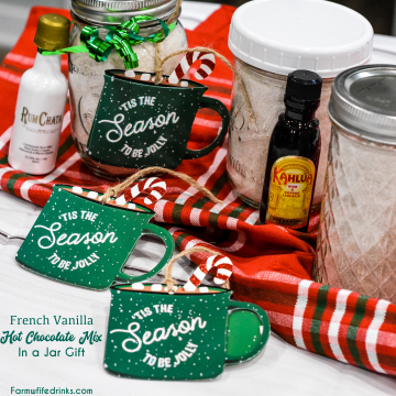 French vanilla hot chocolate mix and a bottle of Rumchata is an easy to make mason jar drink mix gift made with dried milk, Nesquik, french vanilla creamer, pudding, and powdered sugar.